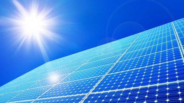 solar-panels-under-blue-sky-and-sun-flare-640x360.jpg